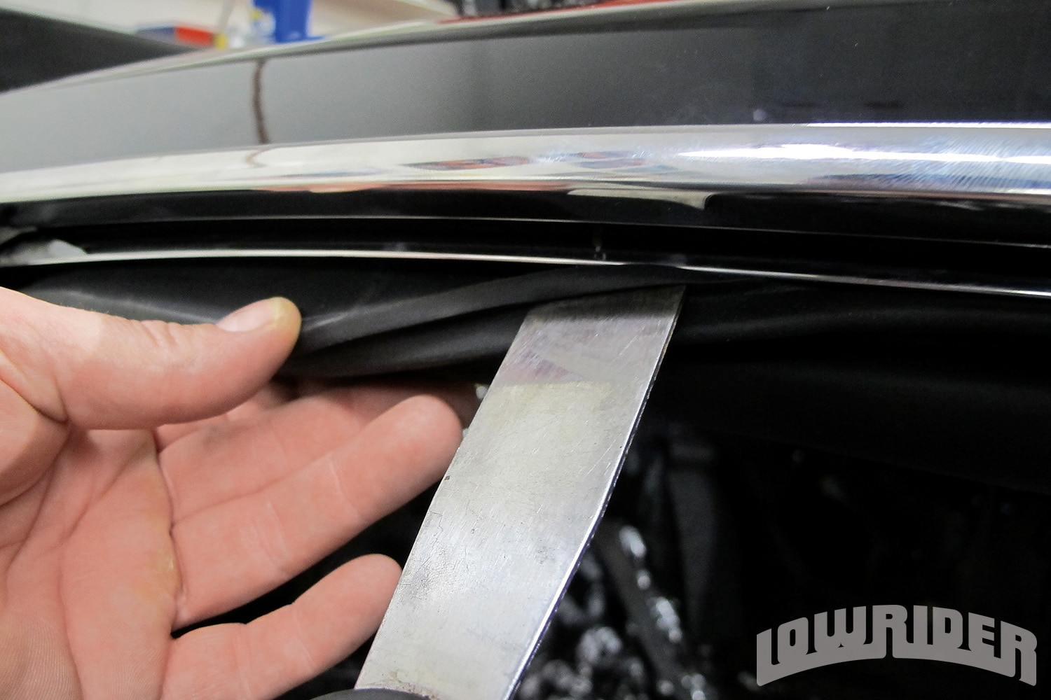 <strong>13</strong>. Using a flat putty knife allowed the weatherstrip to go on.