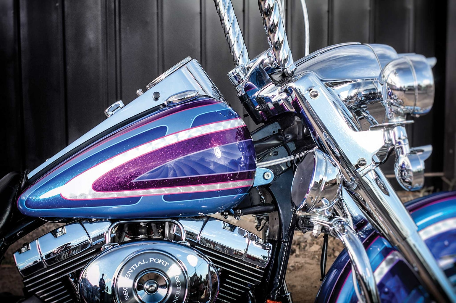 Twisted ape hangars, extended fishtails, and killer custom paint make this Road King the king of the road!