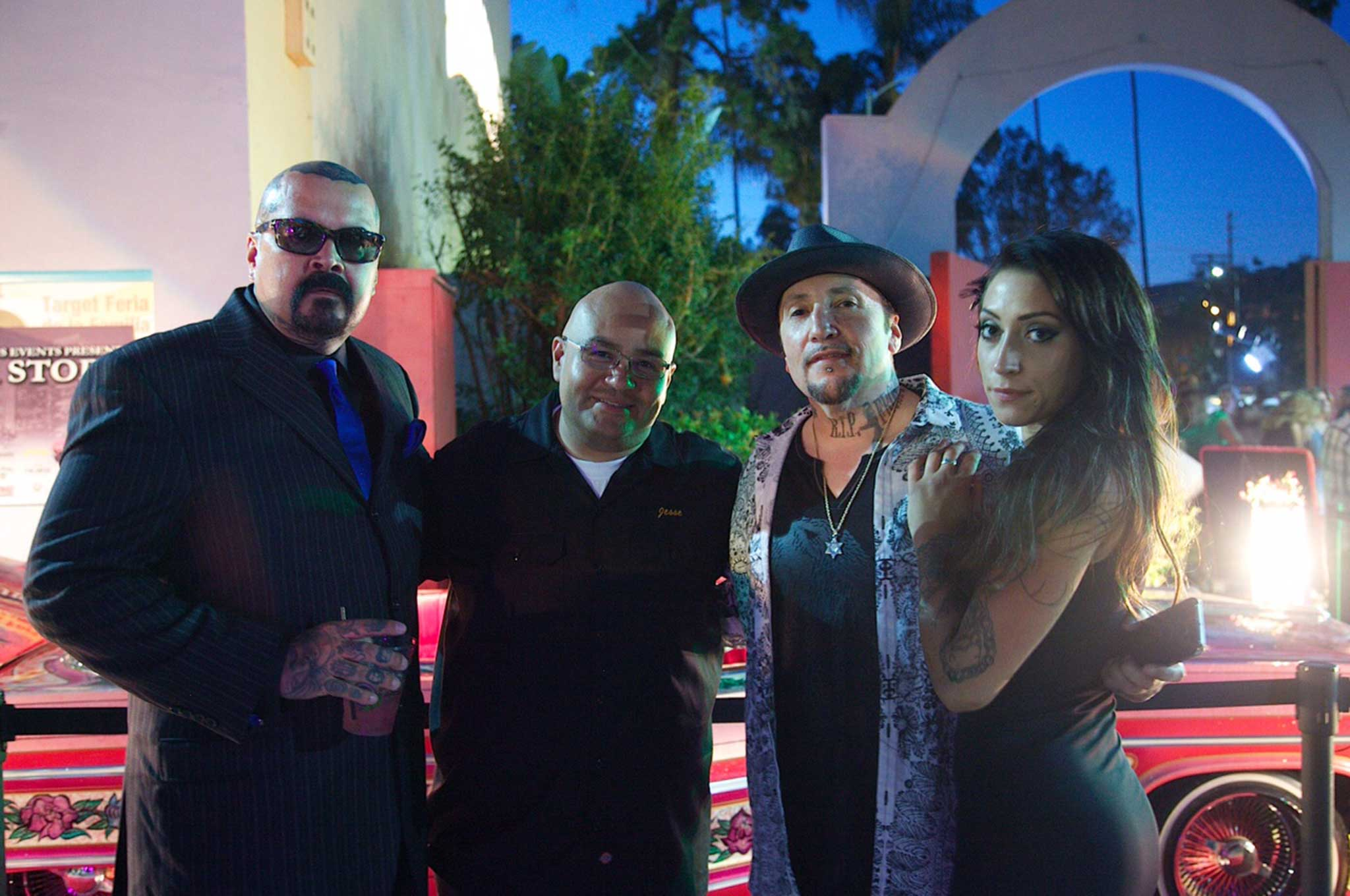 LA Story host Compton Dave poses for a photo in front of Gypse Rose with Jesse Valdez and famed tattoo artist Freddy Negrete