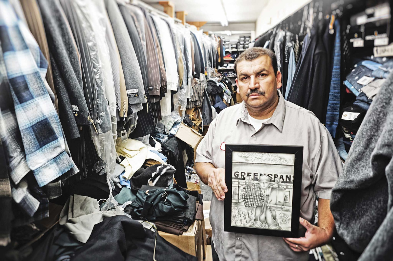 Raul is a longtime customer who has been shopping with Greenspan's since he was a kid. He's seen here standing besides some artwork he contributed to Evan for a special shop collaboration tee.