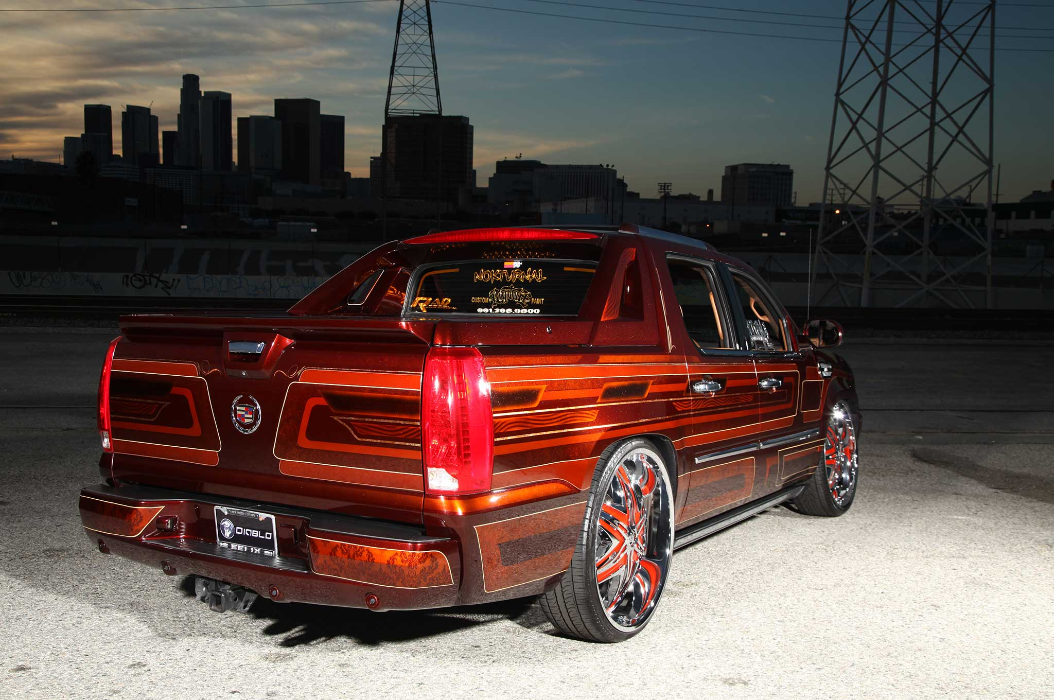 A 2008 Cadillac Escalade EXT on Diablo Wheels - Lowrider