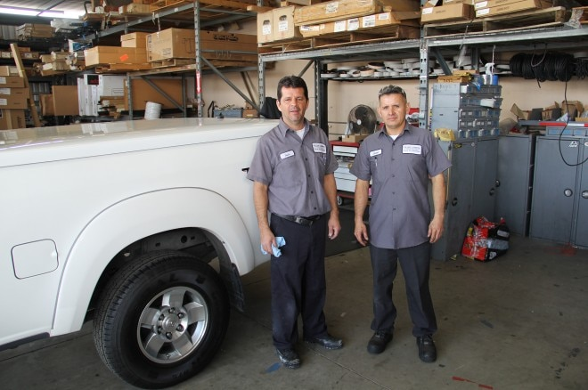 19 fuller truck accessories employees luis and jose with completed truck