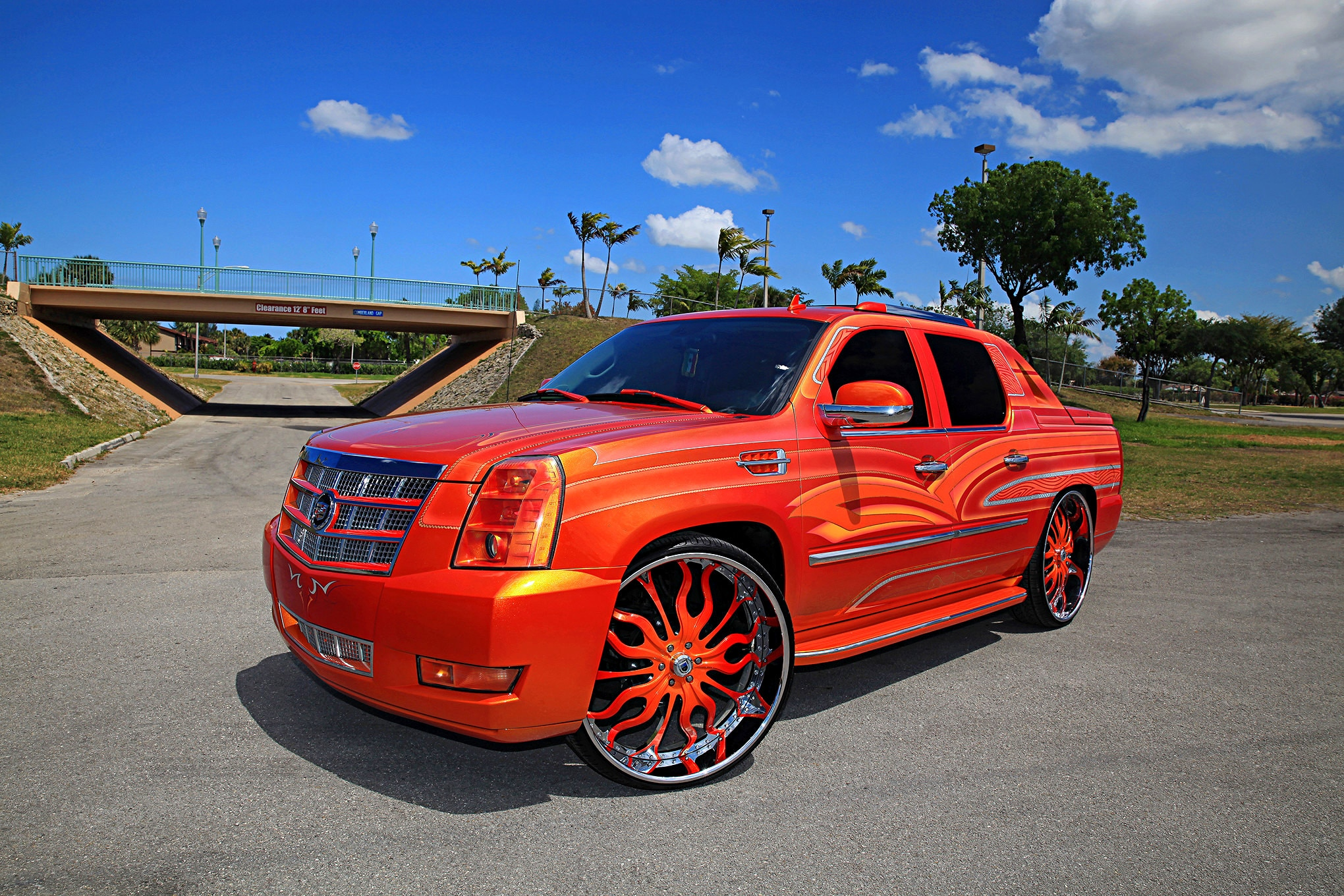 https://st.lowrider.com/uploads/sites/7/2016/08/2009-cadillac-escalade-ext-driver-side-front-view.jpg