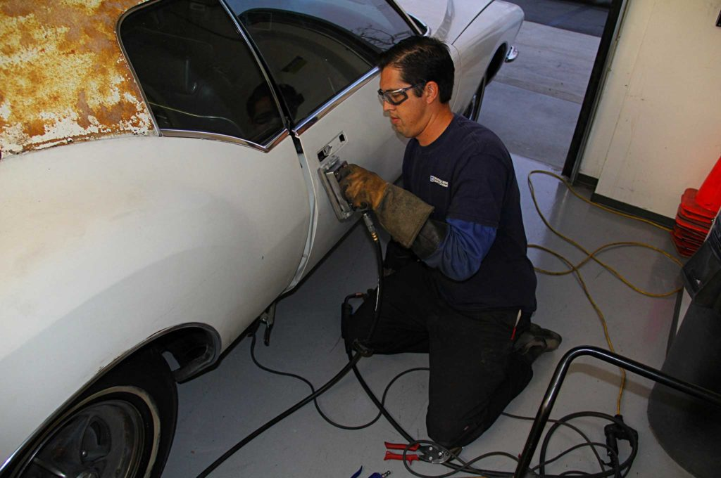 refining the fine lines of project riviera boat tail door panel angle grinding