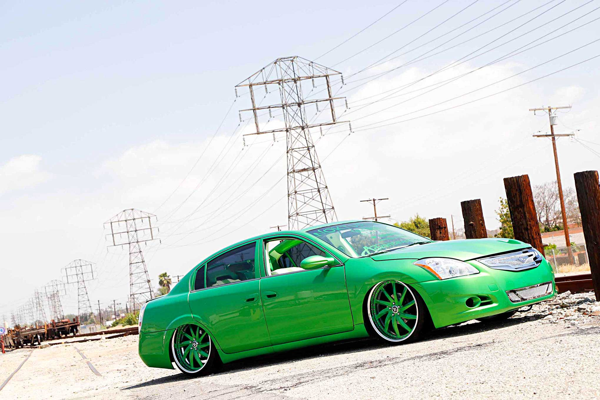 2005 nissan altima passenger side front view lowriderabout this editor